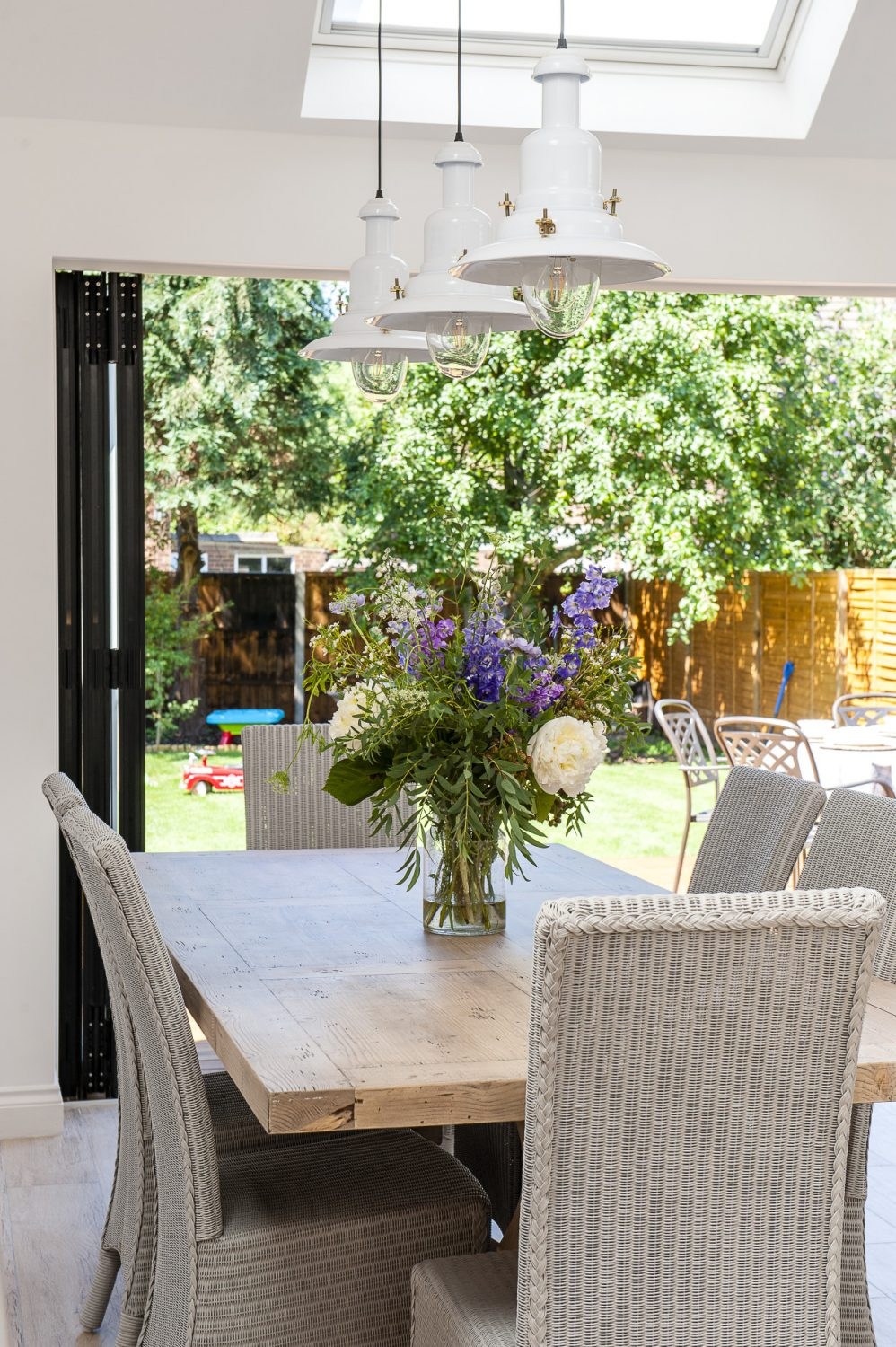 Bi-fold doors open the entire back of the house onto the garden