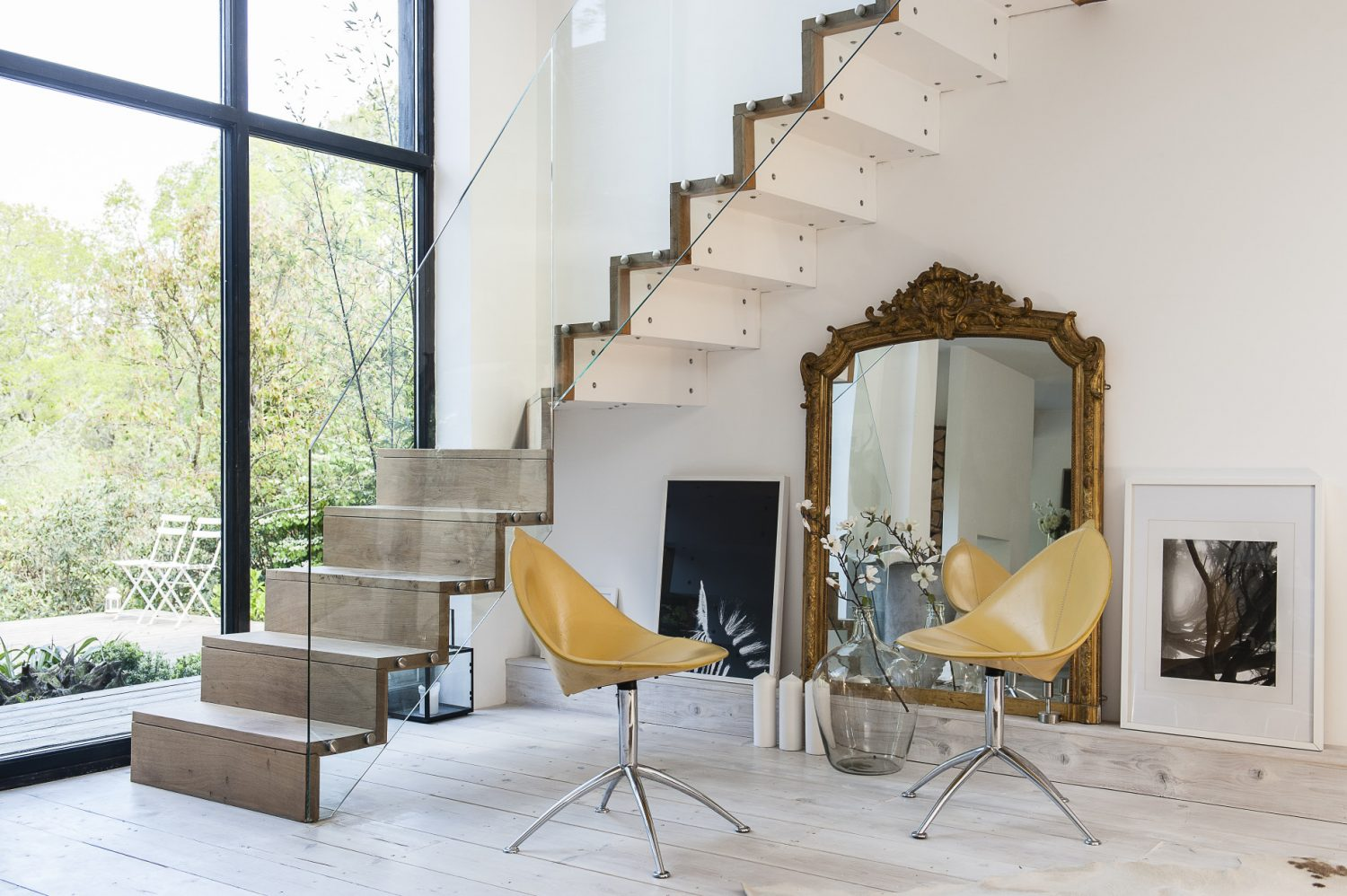 Designed by Sue together with Roy, a talented steel fabricator, the staircase is crafted from steel and encased in green oak with glass balustrading