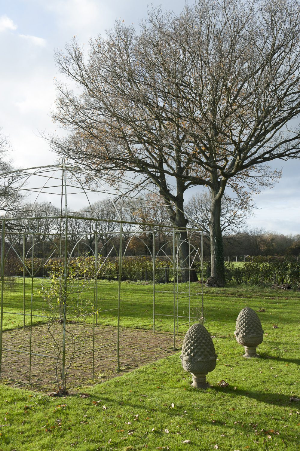 Sarah is kept busy tending the large garden, which includes a duck pond, fruit trees and trellises, as well as a vast lawn