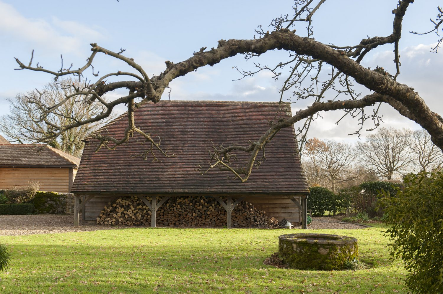 The view from the kitchen window, across the lawn to the oak-framed, cart-shed-style garage