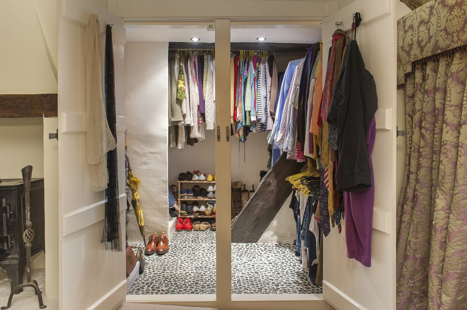 Sarah used a darker version of the pebble flooring in the wet room for the couple's walk-in wardrobe