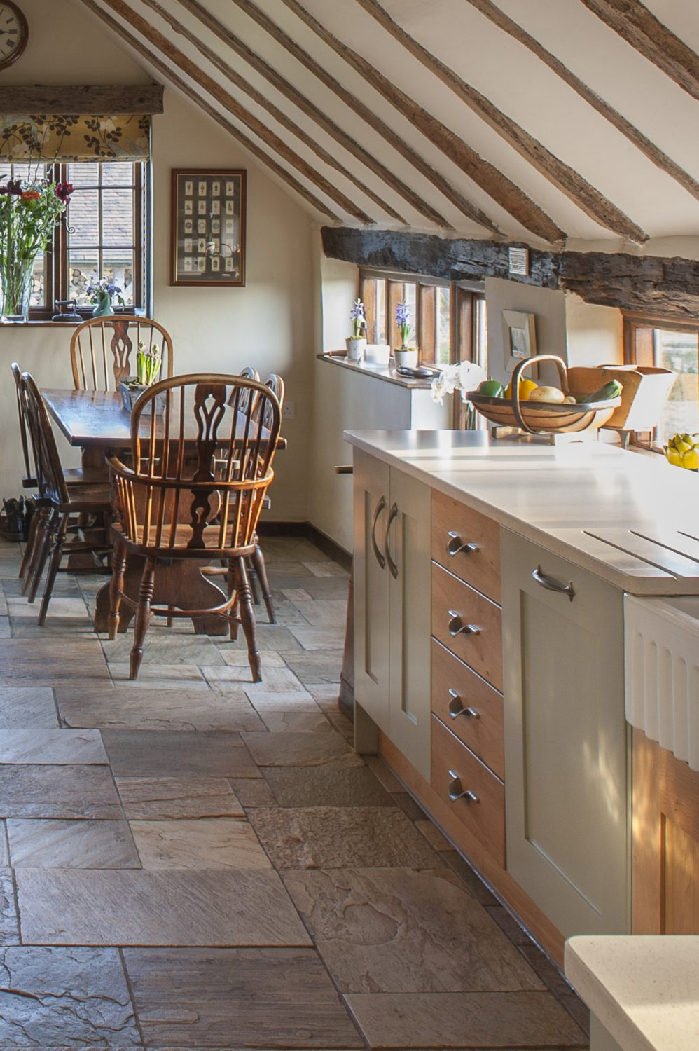 The kitchen's flag-stone floor was already in place when the couple bought the farmhouse and is ideal in a household where visitors often have muddy wellies – or muddy paws