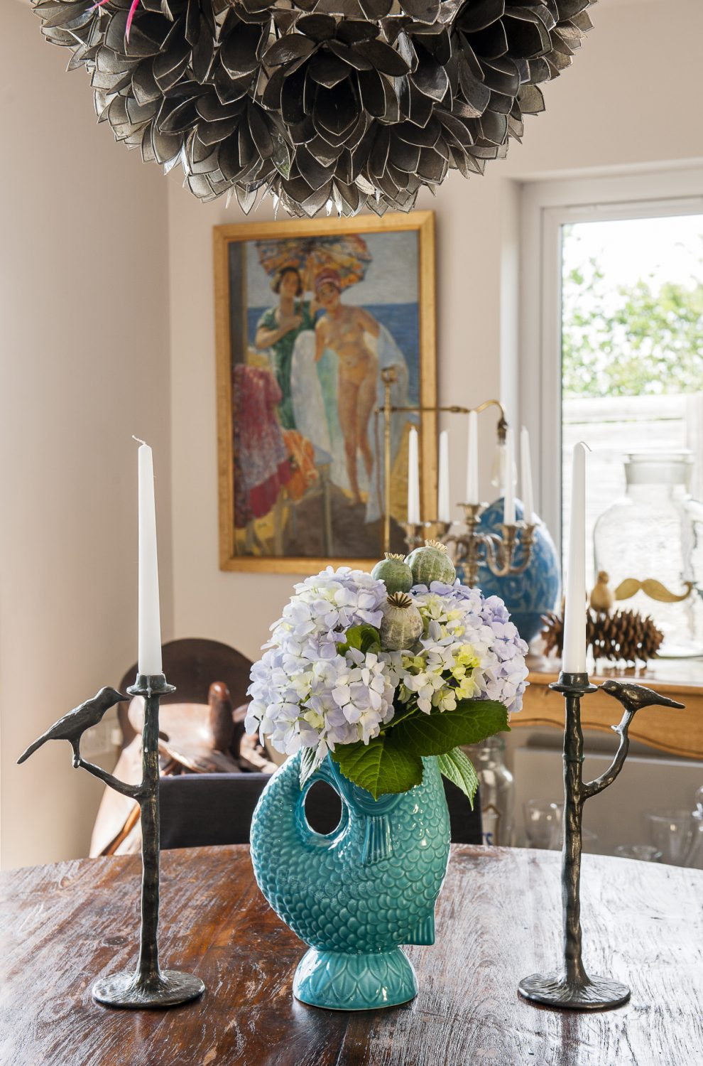 The blue fish 'gluggle jug' is from Harborough Nurseries. The bronze candlesticks were a gift