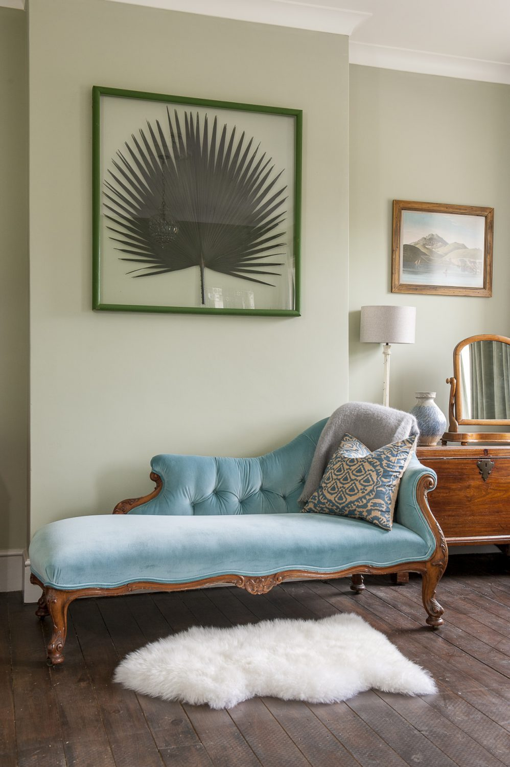 The chaise longue in George's Room is covered in turquoise velvet by Clarke & Clarke and the sheepskin on the floor next to it is from Hunter Jones, Rye