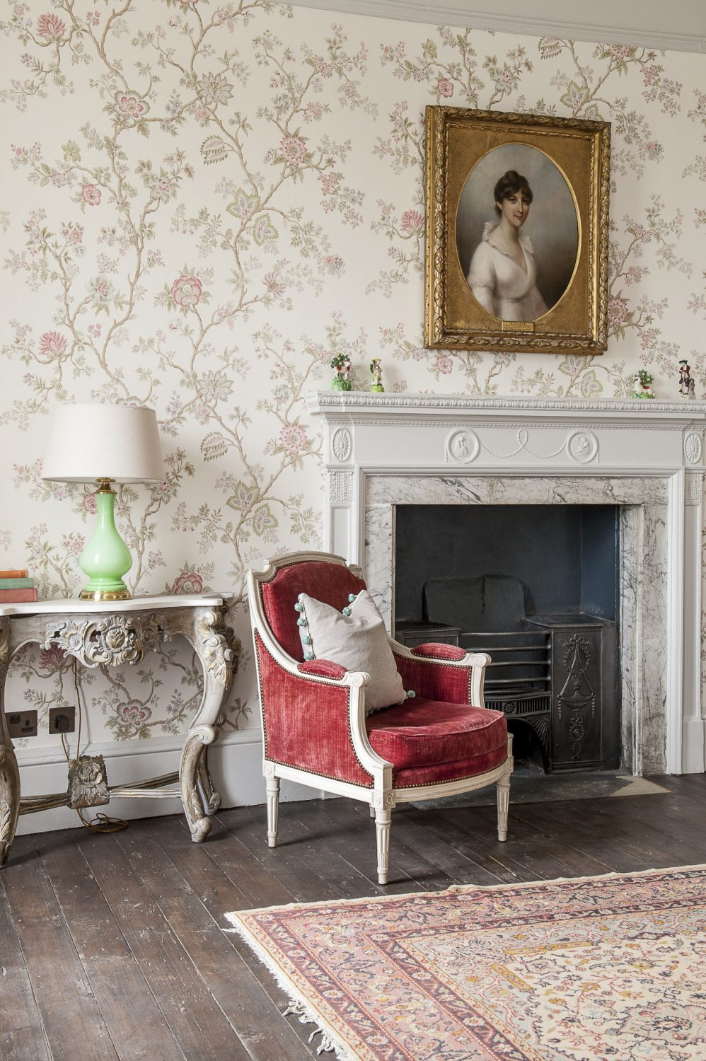 The wall sconces, portrait, green glass lamp and console table are all Ardingly finds