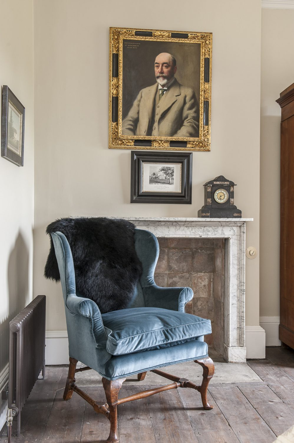 The portrait and clock are family pieces. The armchair is covered in Ashwell Sea Storm, by GP & J Baker