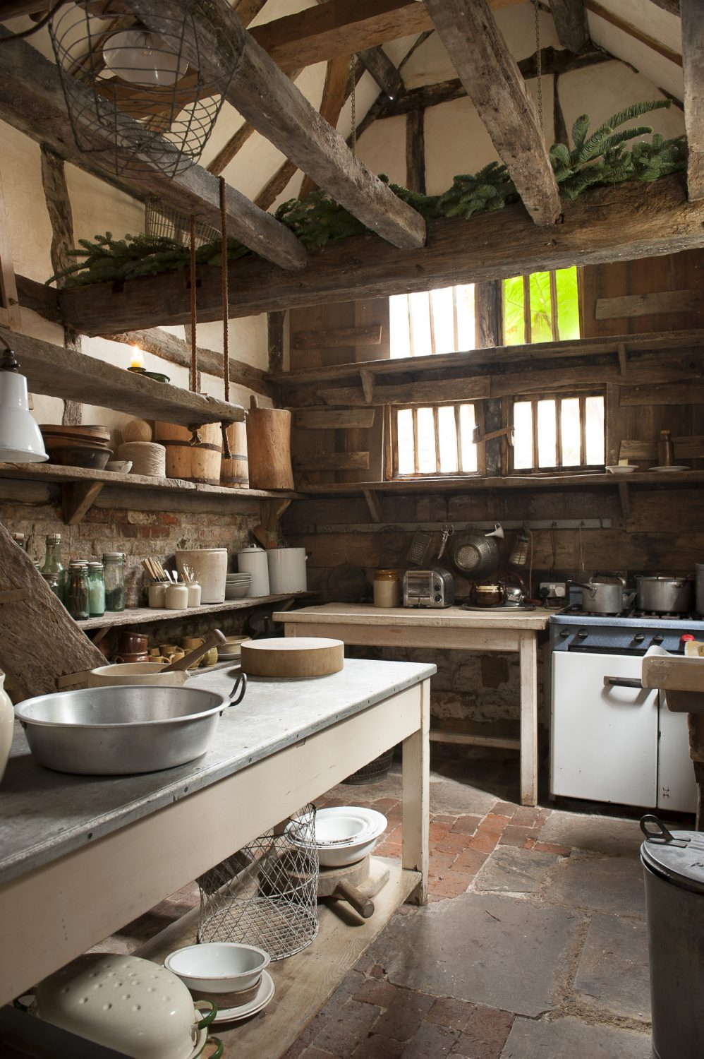 Whereas mod cons like plumbing and lighting are cunningly concealed out of sight in the rest of the house, hints of modern-day living and appliances can be spotted in the kitchen