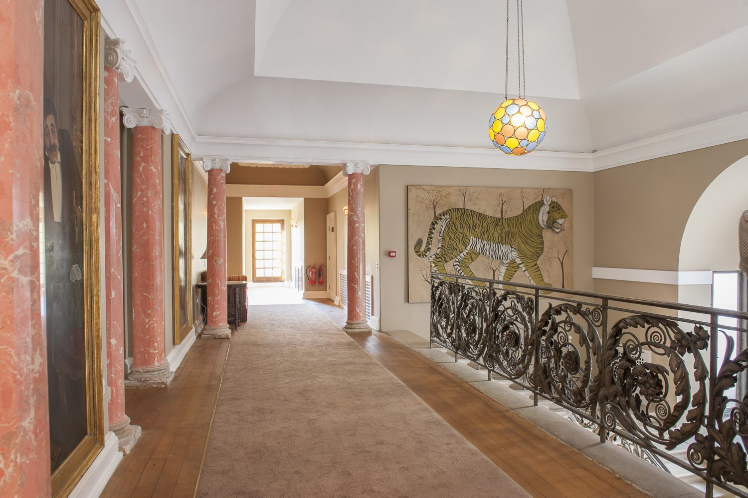 The landing area with pink marble columns