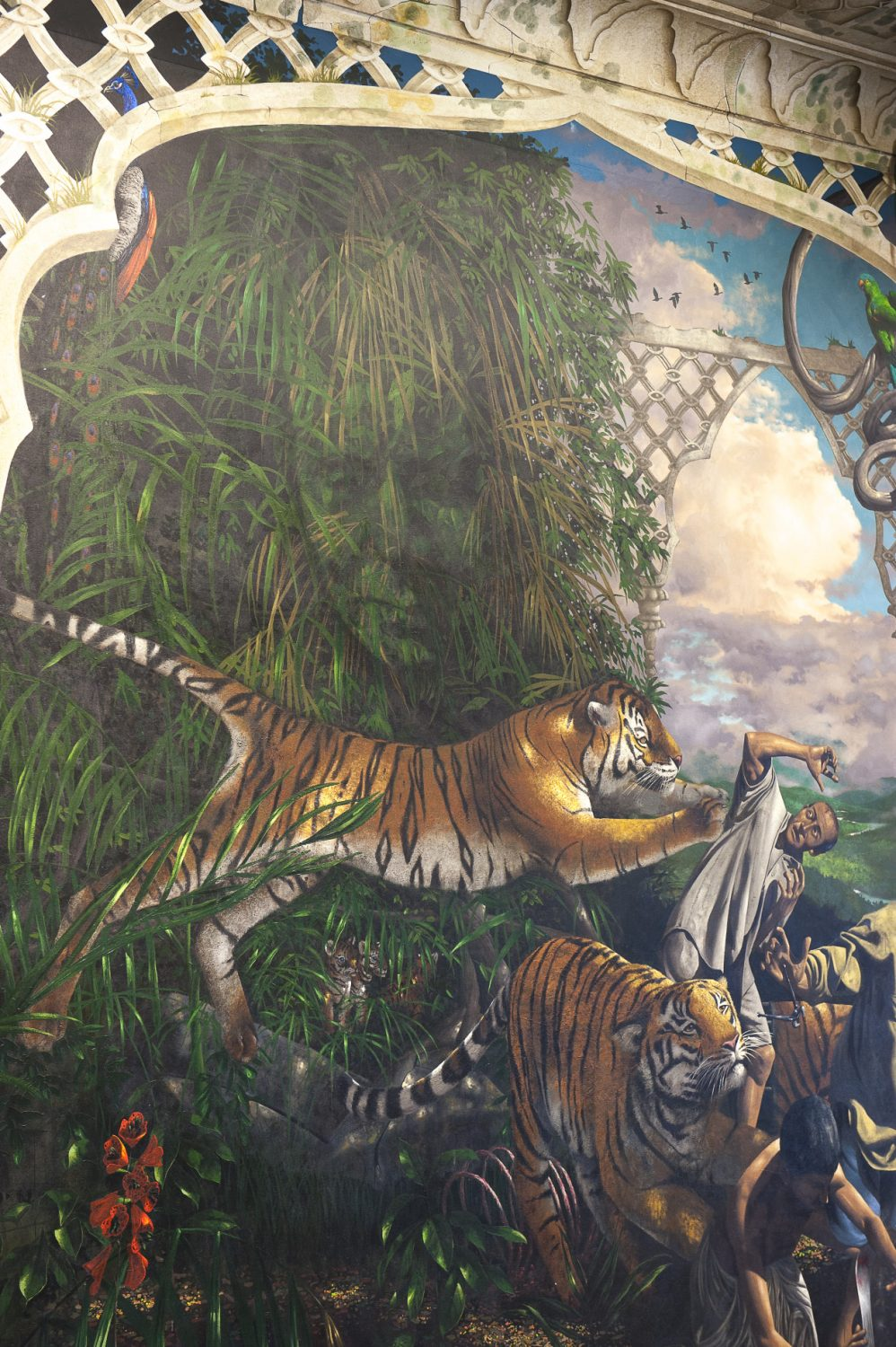 In the Martin Jordan meeting room floor-to-ceiling murals depict scenes of endangered wildlife. Subtly painted to be disguised within foliage, and only visible from certain angles, the face of John Aspinall looms above a tiger defending her young from poachers – a poignant reminder of the plight of some of the world's most vulnerable species and how they must be protected