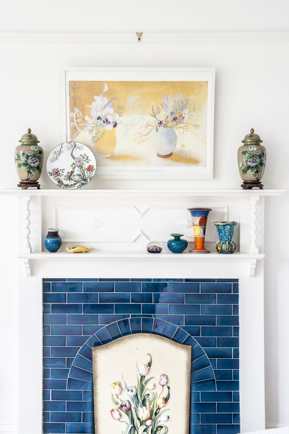 The tiled fireplace in the master bedroom