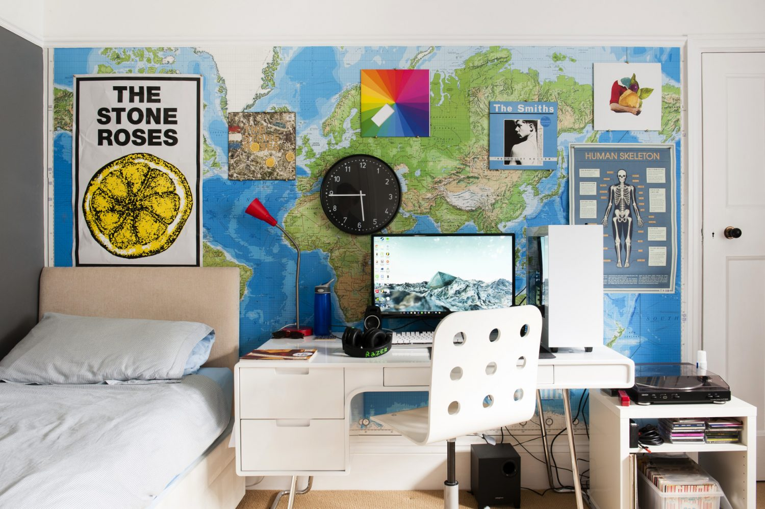One wall of son Finn's bedroom is papered with a world map and hung with favourite album covers