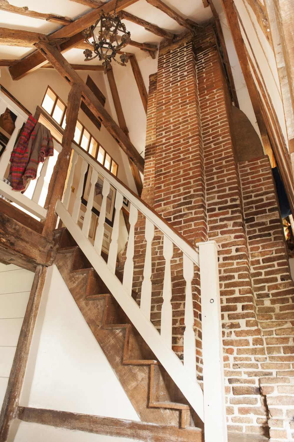 Despite its ancient origins, the house has been sensitively updated over the years. Fans of classic Wealden buildings are in for a treat, as the eye is led upwards by the most enormous chimney of local brick and lime mortar which juts into the roof space
