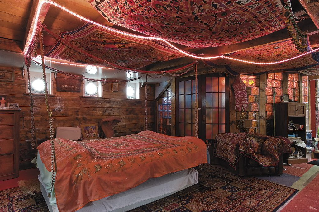"""the bedroom in the summer quarters has a bed suspended from the ceiling. """"Sleeping on a swinging bed is amazing,"""" says Eileen. """"If you can't sleep you just have to pull one of the ropes to rock yourself to sleep – I recommend it."""""""