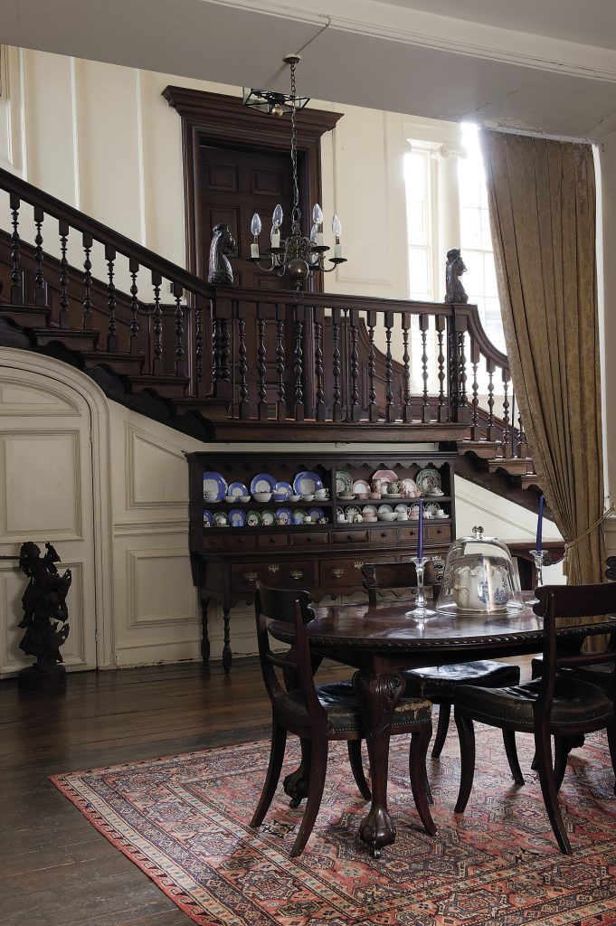 A door in the corner of the State Dining Room leads into a smaller, more informal dining room. The oval dining table has just four Regency chairs around it and the room feels far more intimate even though it is completely open on one side to the hallway that runs alongside the Grand Staircase
