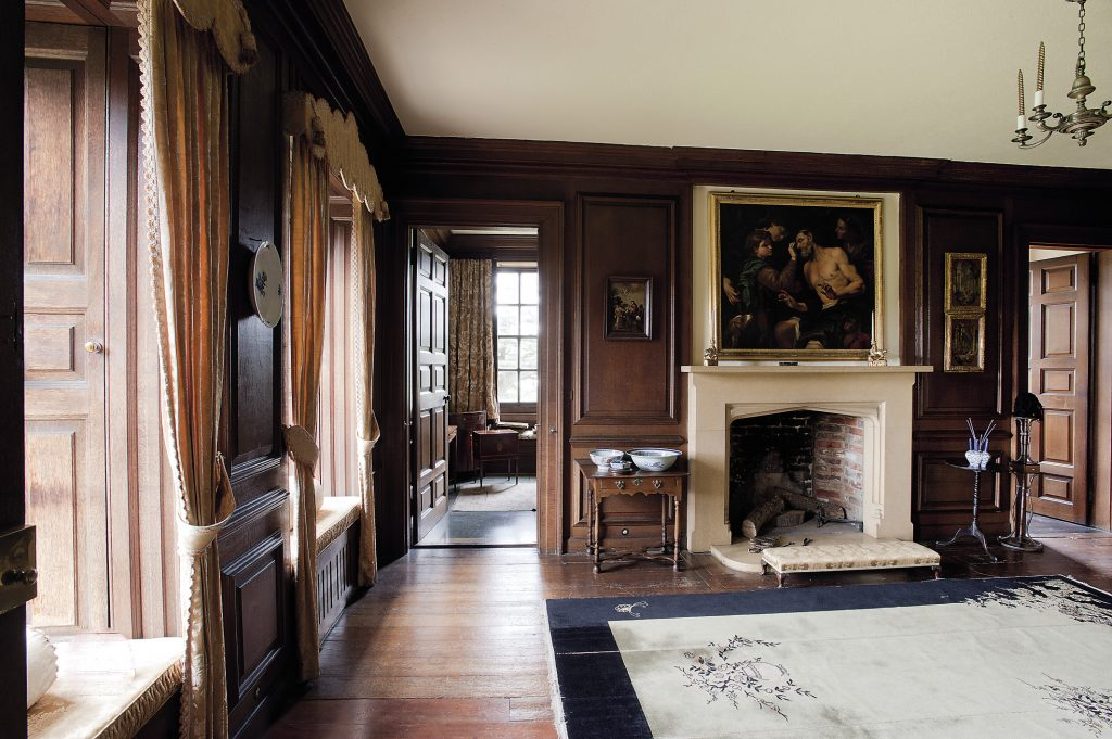 Light pours into the State Bedroom of Queen Anne. Above the fireplace hangs a painting by Jan Carl Loth which dates from the eighteenth century