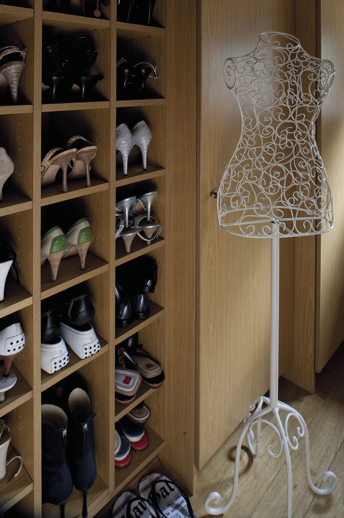 The shelves of Candy's dressing room are home to an enviable collection of shoes