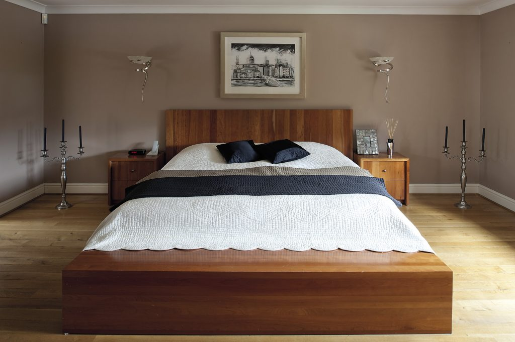 The master bedroom is spare and surprisingly masculine in tone