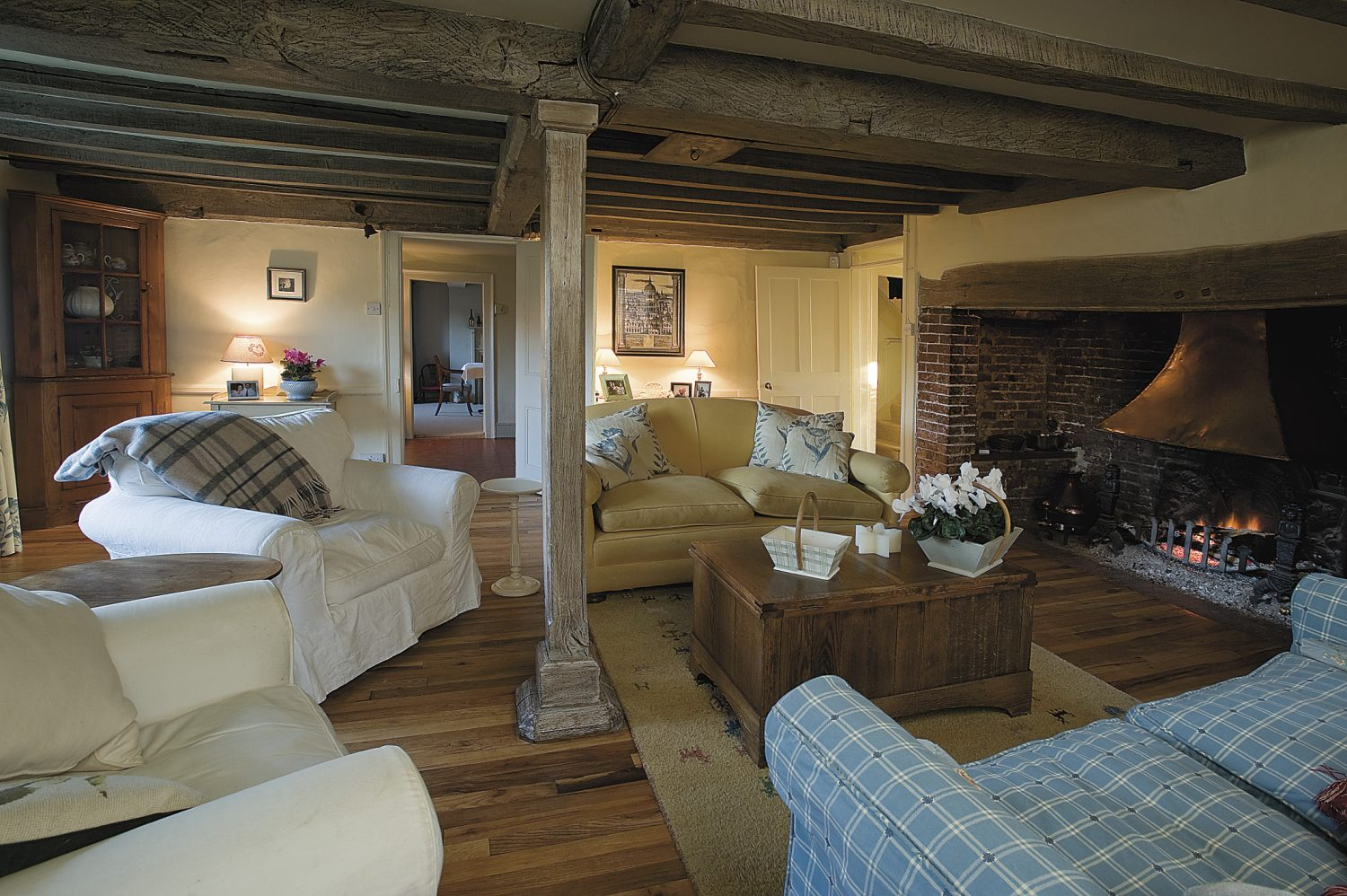 the sitting room was originally the farmhouse kitchen. The beams have been sanded, limed and waxed