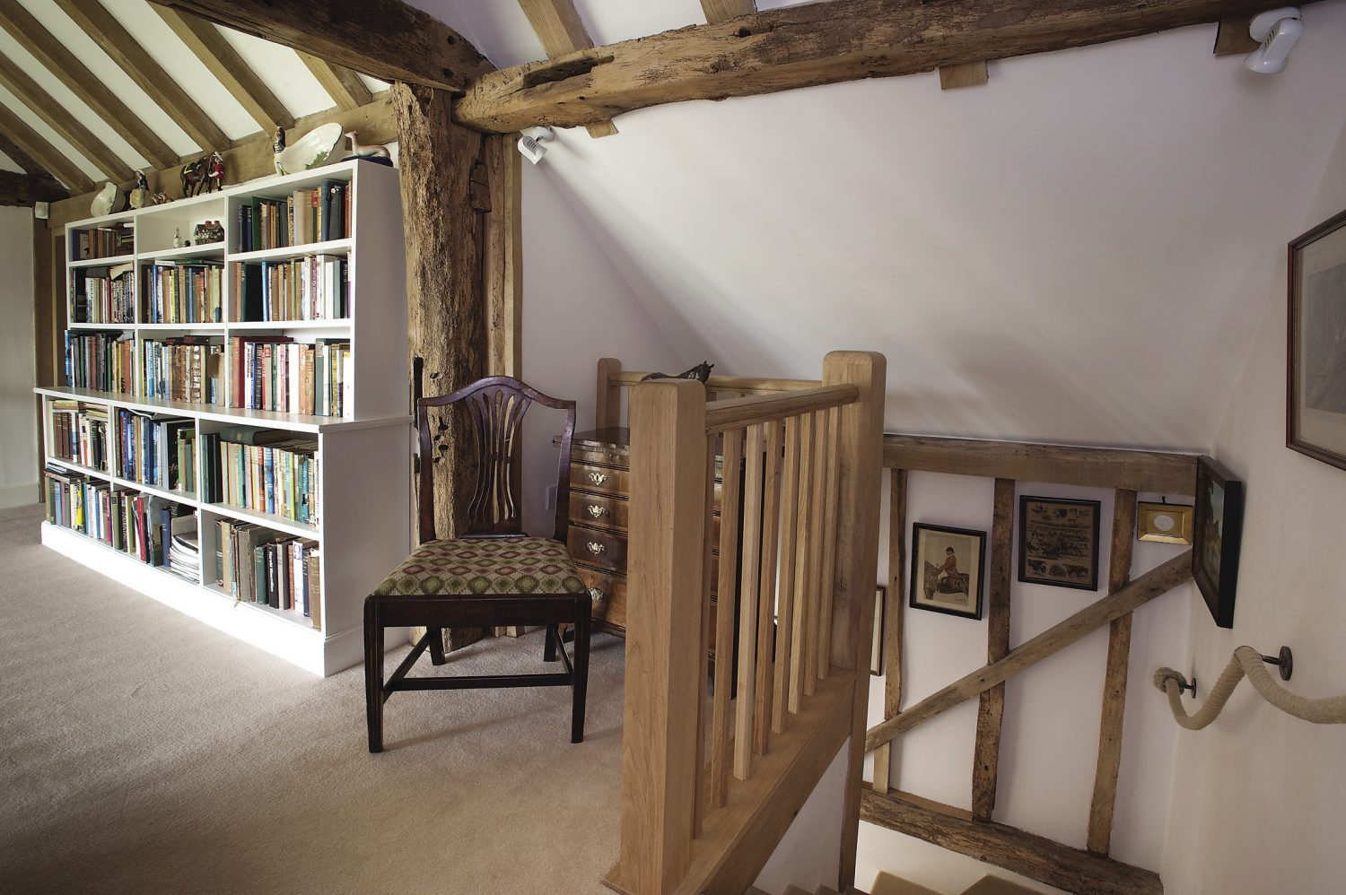 bookshelves made by Alpine Joinery of Frant stretch almost the length of the landing