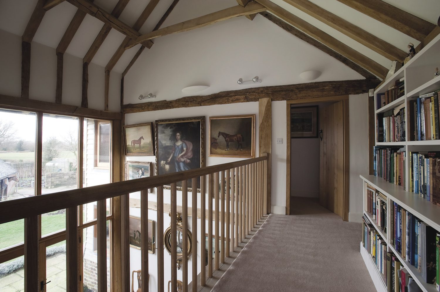 watercolours are hung on the north, and oils on the south-facing wall as they're not so susceptible to fading. Horses are the dominant subject