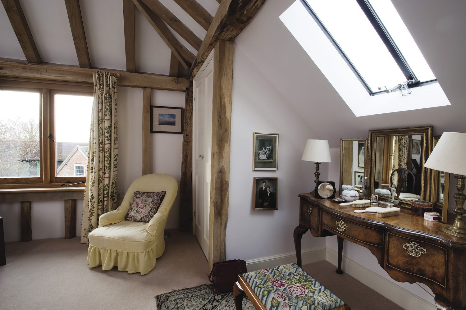 the couple's bedroom has views towards both the North and South Downs.