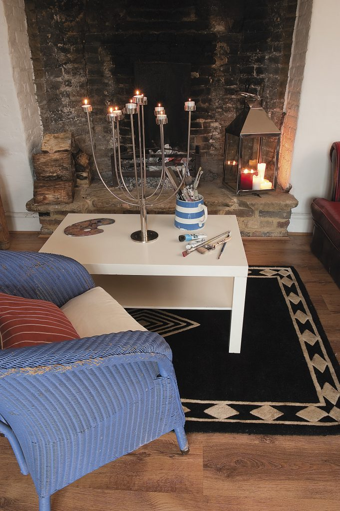 he fireplace in the original hunting lodge; the bar is to the right of the ornate fireplace, part of the 1970s extended section of the room