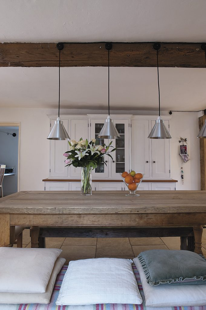 the generous kitchen/dining room was created out of two rooms