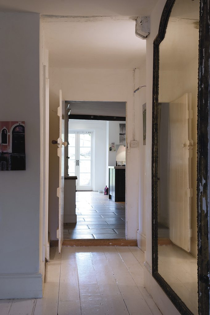 coming into the hall through the front door, you can now see right through to the fields beyond
