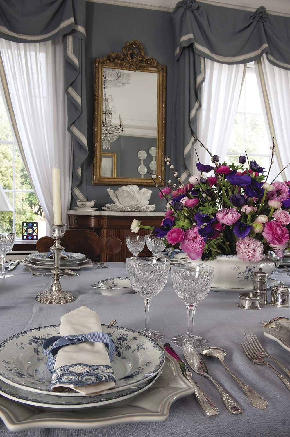 The dining chairs are genuine Gustavian antiques that Theodora bought at Christie's in London