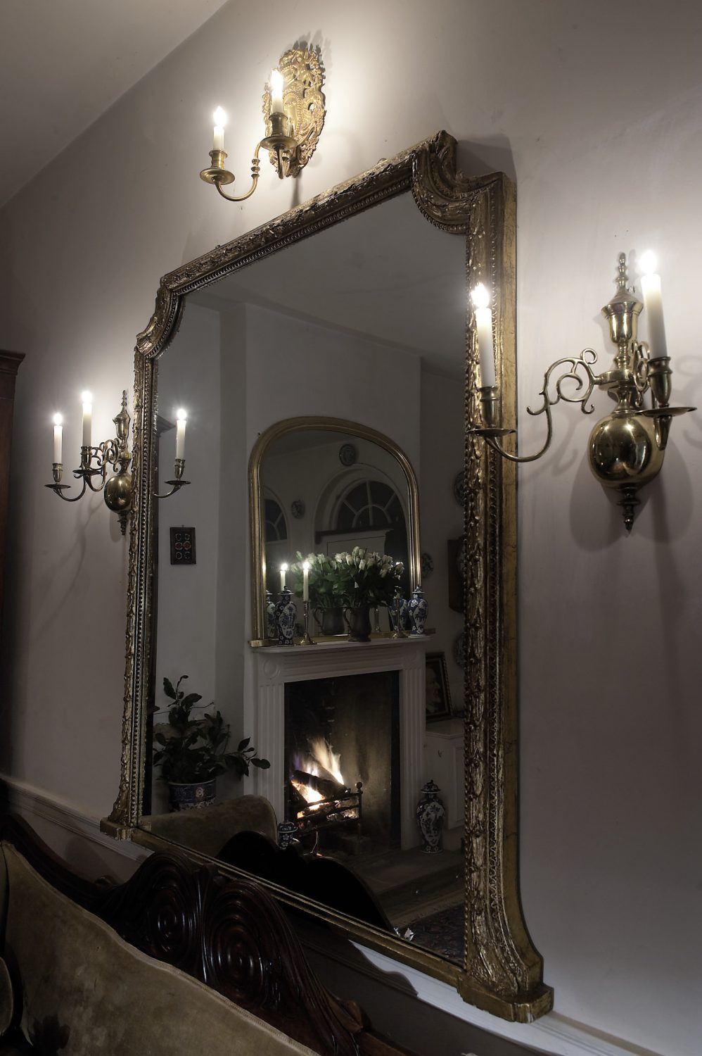 Mirrors throughout the house magnify the sense of space