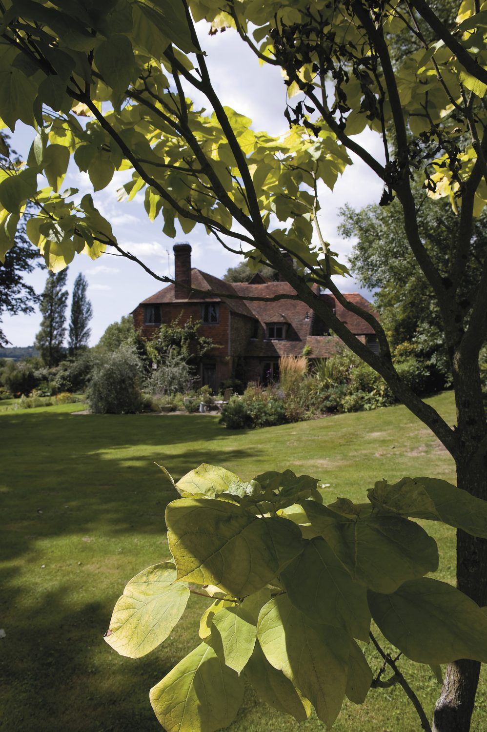The three-bay hall house built during the reign of Elizabeth 1 sits in five acres of gardens which are a haven for wildlife