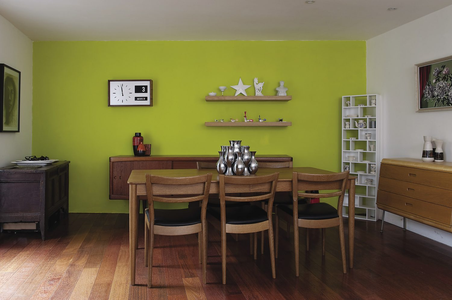 Displays in the L-shaped dining and sitting room are evidence of the couple's love of 1950s and 60s design