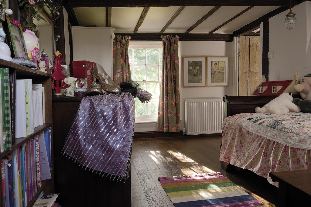Louise's daughter's room features a handsome mahogany sleigh bed covered with another patchwork quilt made by her grandmother