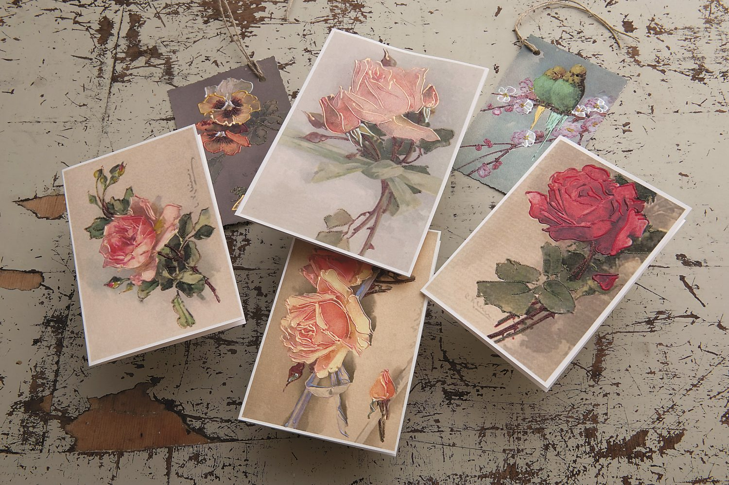 a selection of cards displayed on the distressed dining-room table