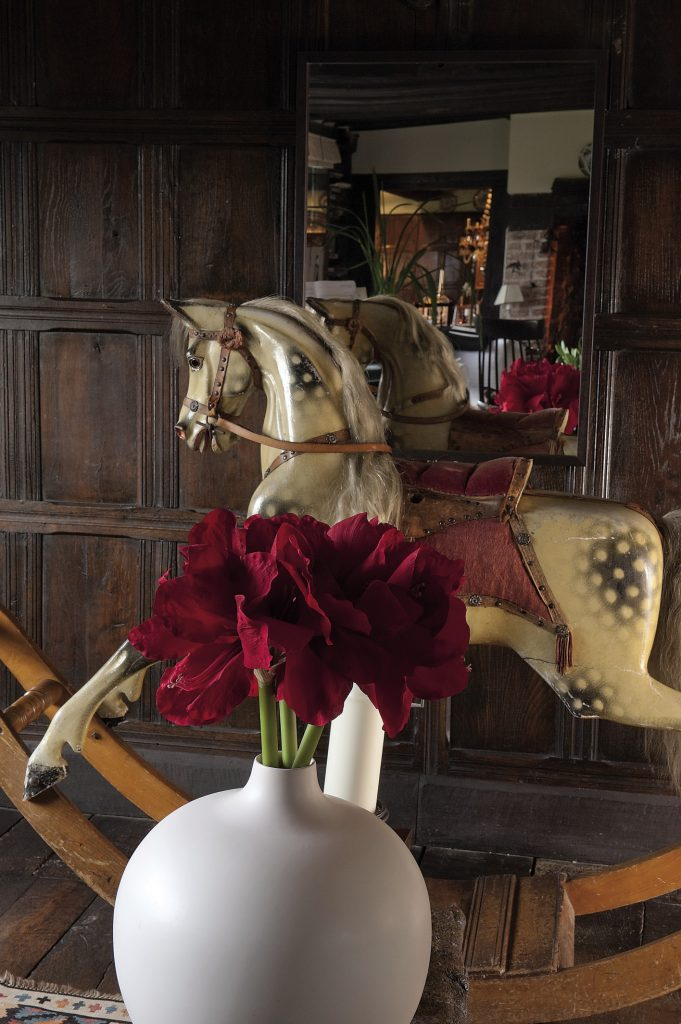 In the drawing room, between two lovely and small chaises longues, stands the perfect traditional rocking horse, its saddle, bridle, mane and tail all gently restored by a local saddler