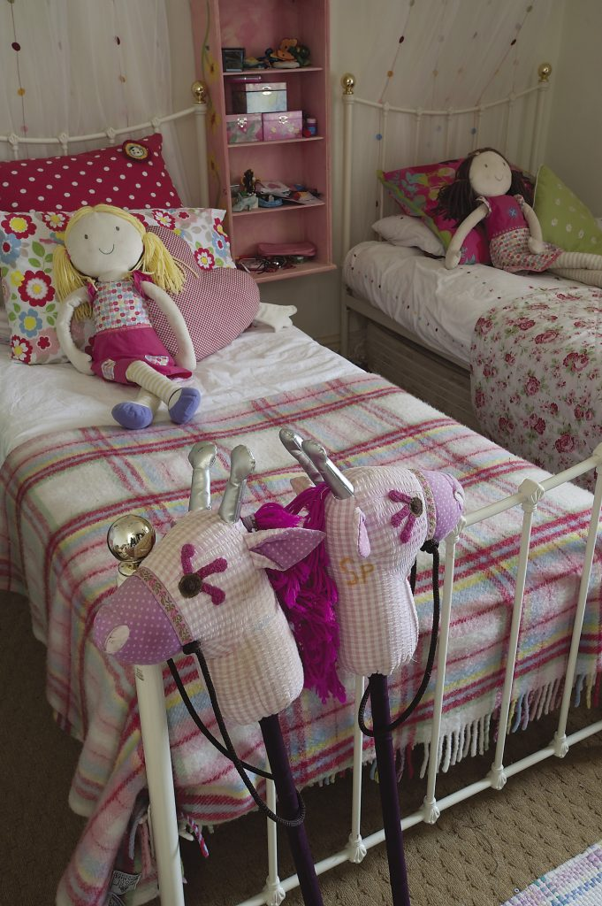 "Canopies have transformed the twin single beds into ""Princess"" beds. in one of the children's rooms"