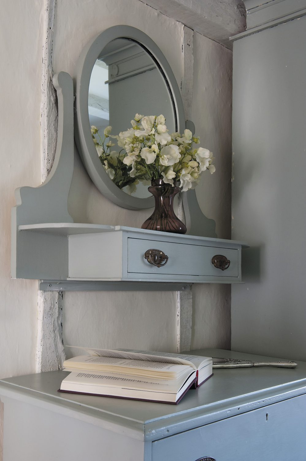 The cool Gustavian grey-blue - Farrow and Ball's Light Blue - in which they have been painted makes the room feel much more spacious