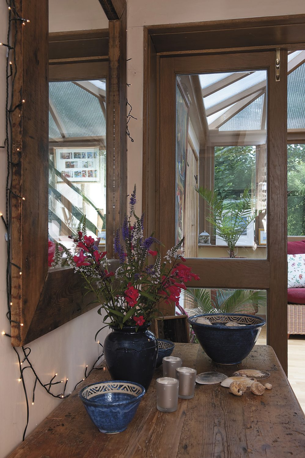 the Wildings added the delightful conservatory which is Christine's favourite summer spot, where she will sit with a cup of tea, a good book and one of the cats!
