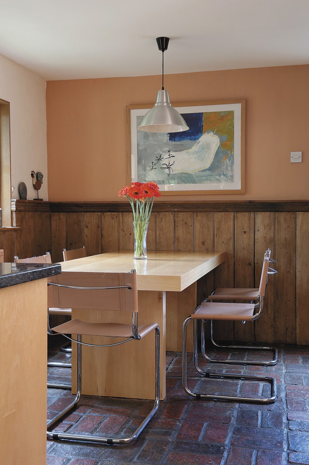 art is a key feature in the home – this piece above the dining table was painted by a college colleague of Barry's