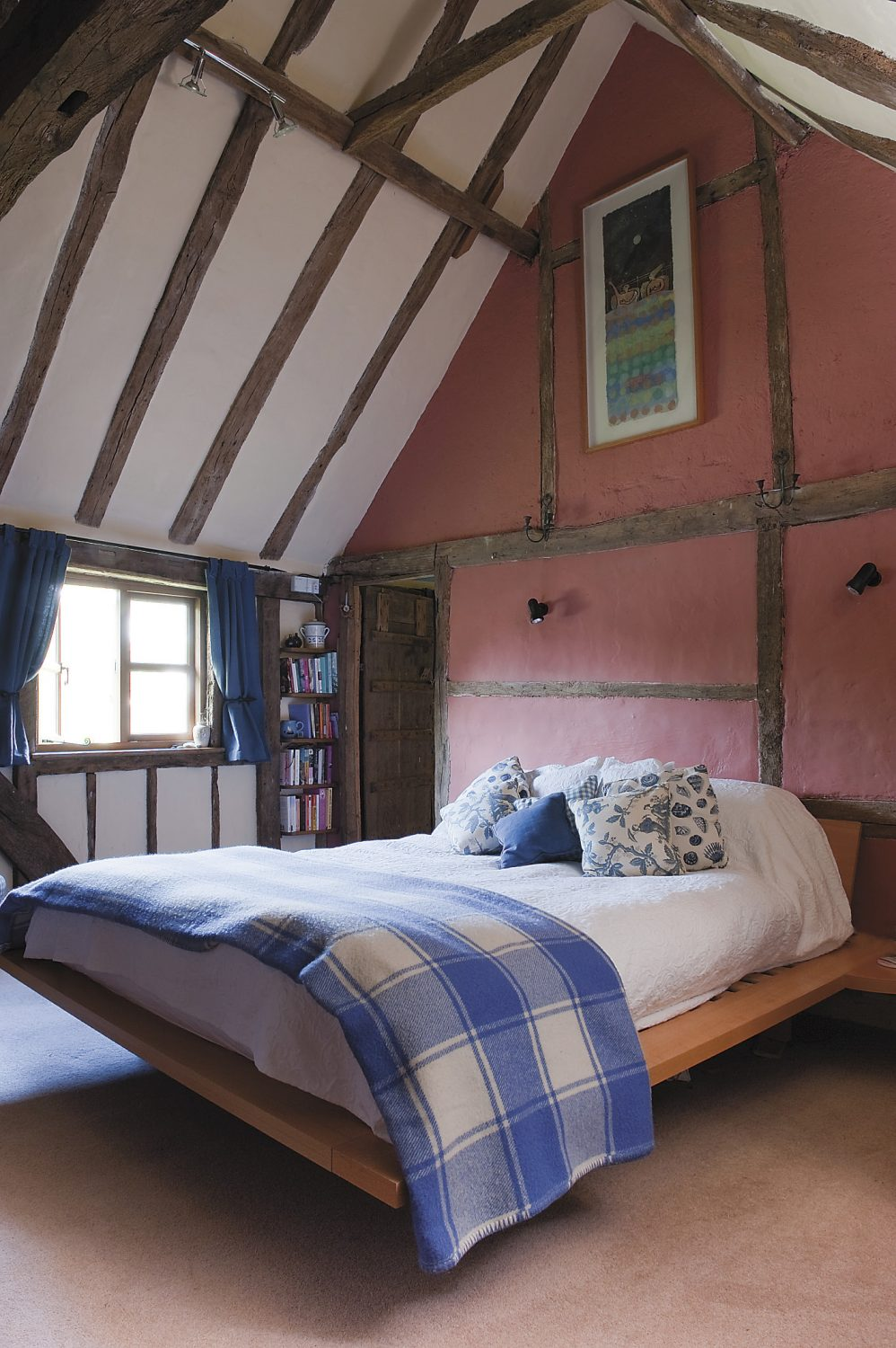 and so to sleep...the magnificent vaulted bedroom is a gem, with exposed timber, the fireplace and wobbly floor