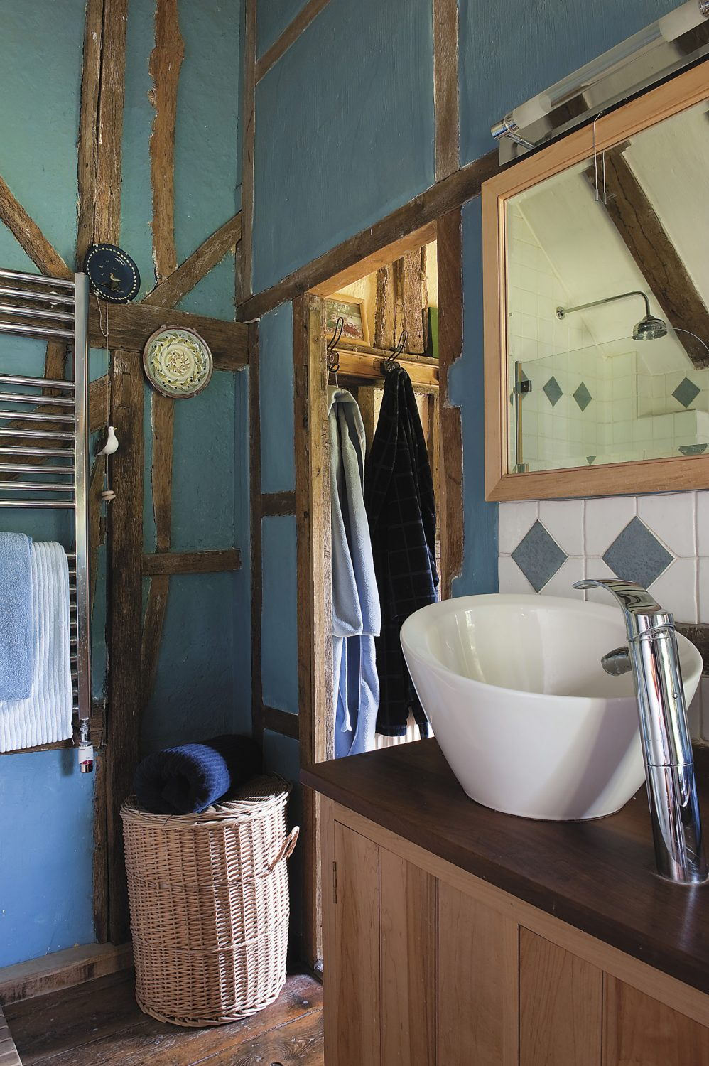 Christine again successfully mixes modern comforts with traditional charm in the en suite bathroom