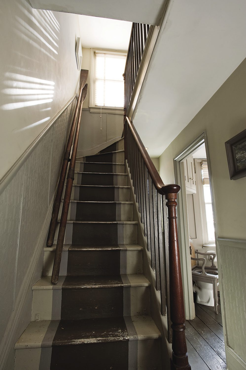 The final flight of stairs lead up to the attic room