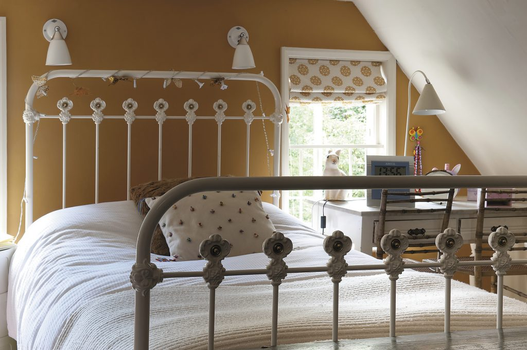 Matilda's bedroom is blessed with a pretty, antique bedstead