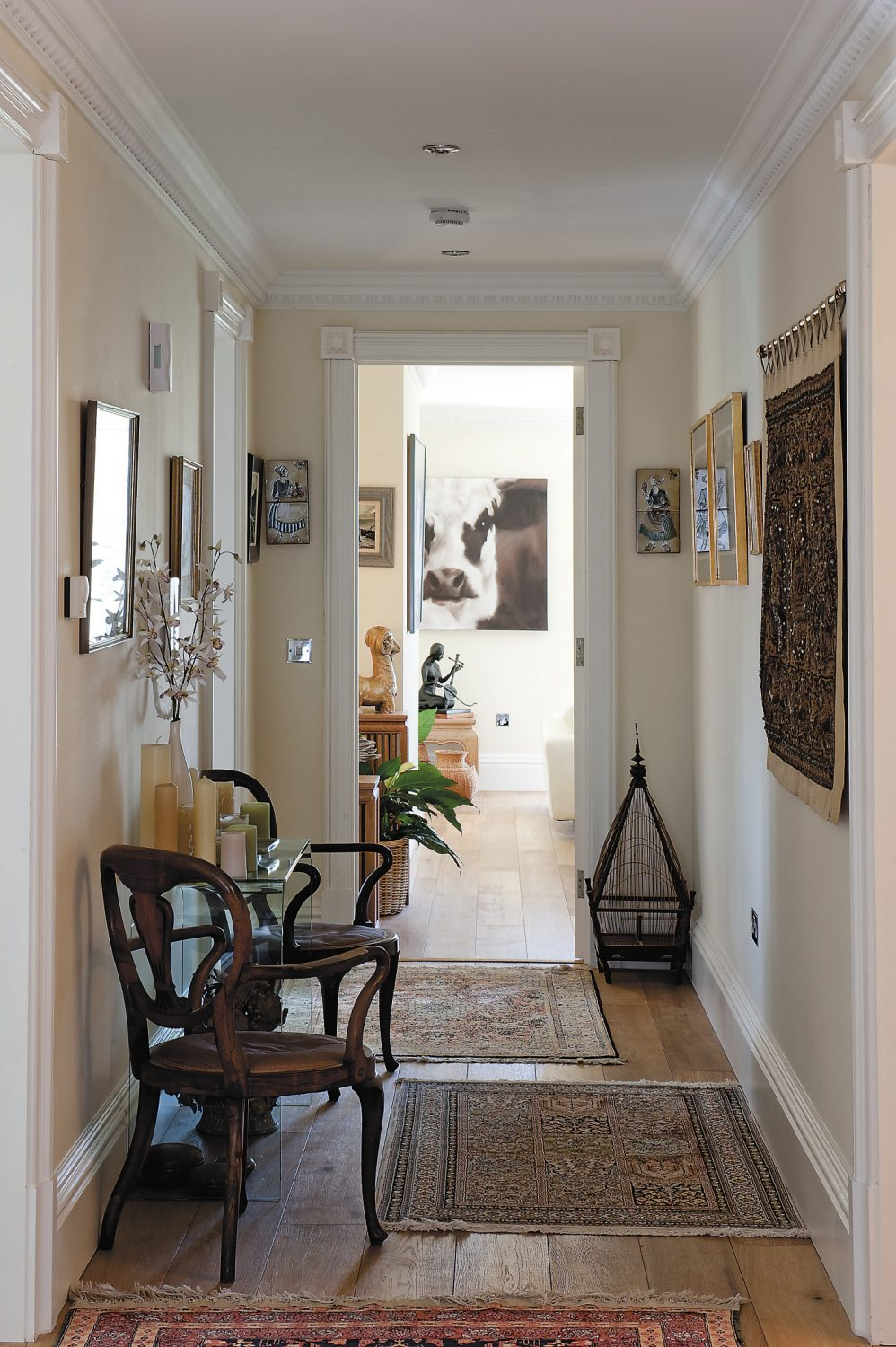 """The hallway is home to """"Uncle Sid's French chairs"""""""