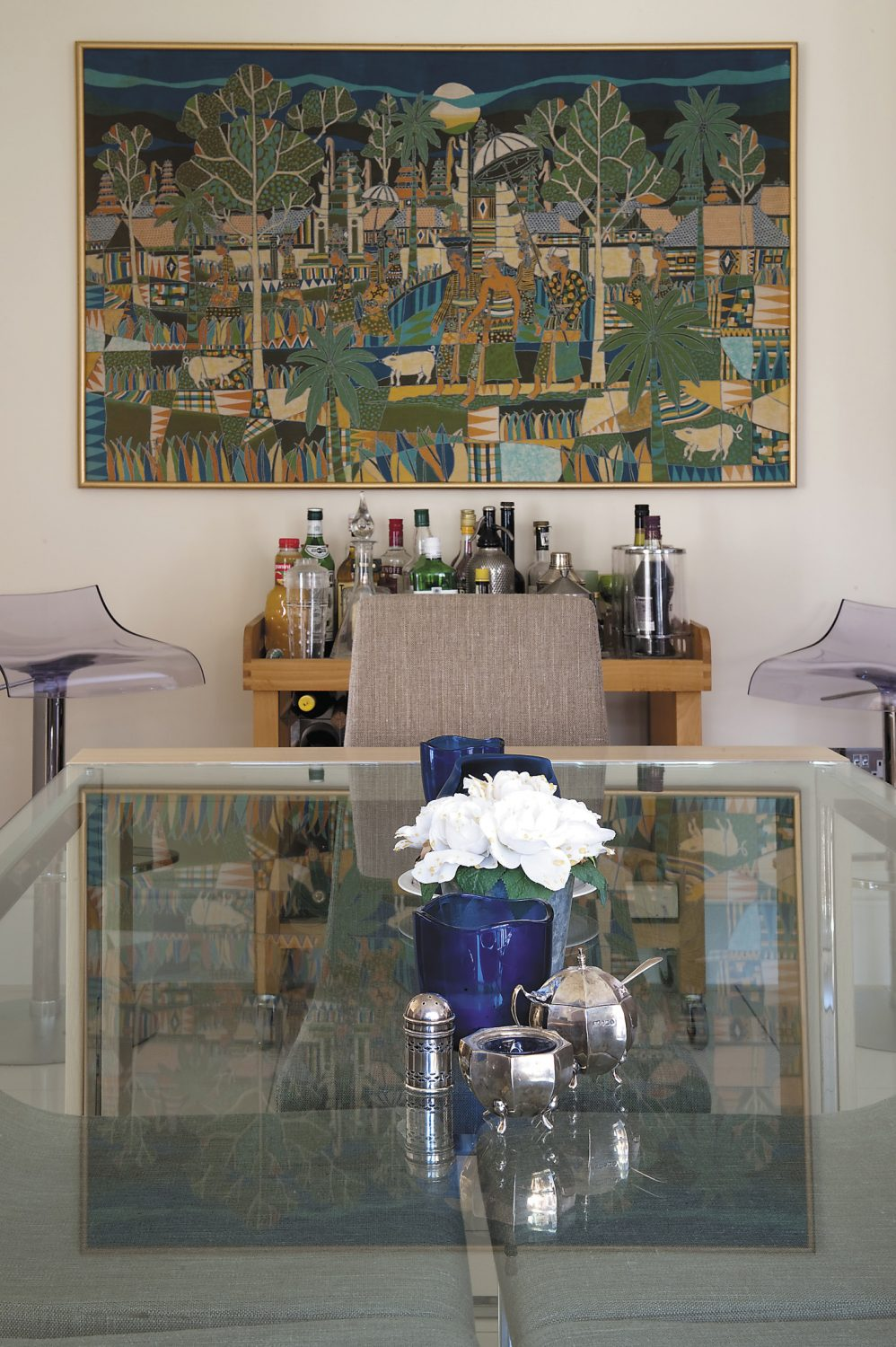 The kitchen's glass dining table was ordered over the internet and came from Italy