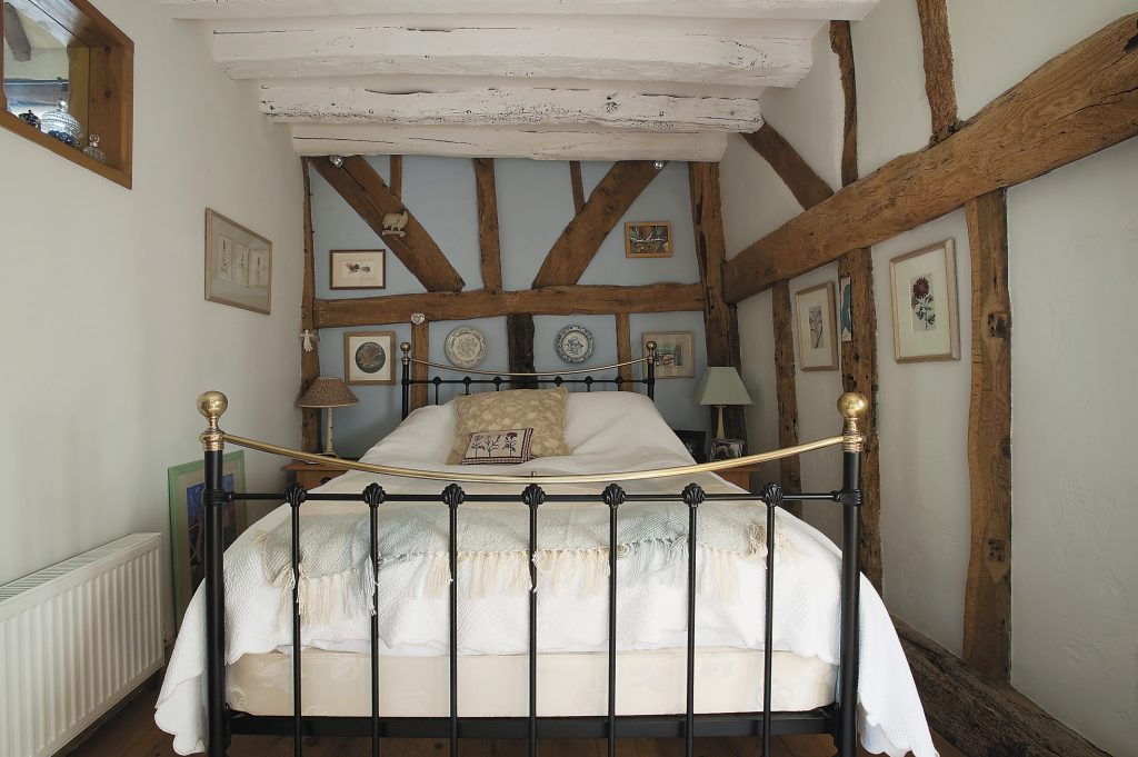 Sophie painted the beams in her bedroom white to add height and lightness bottom