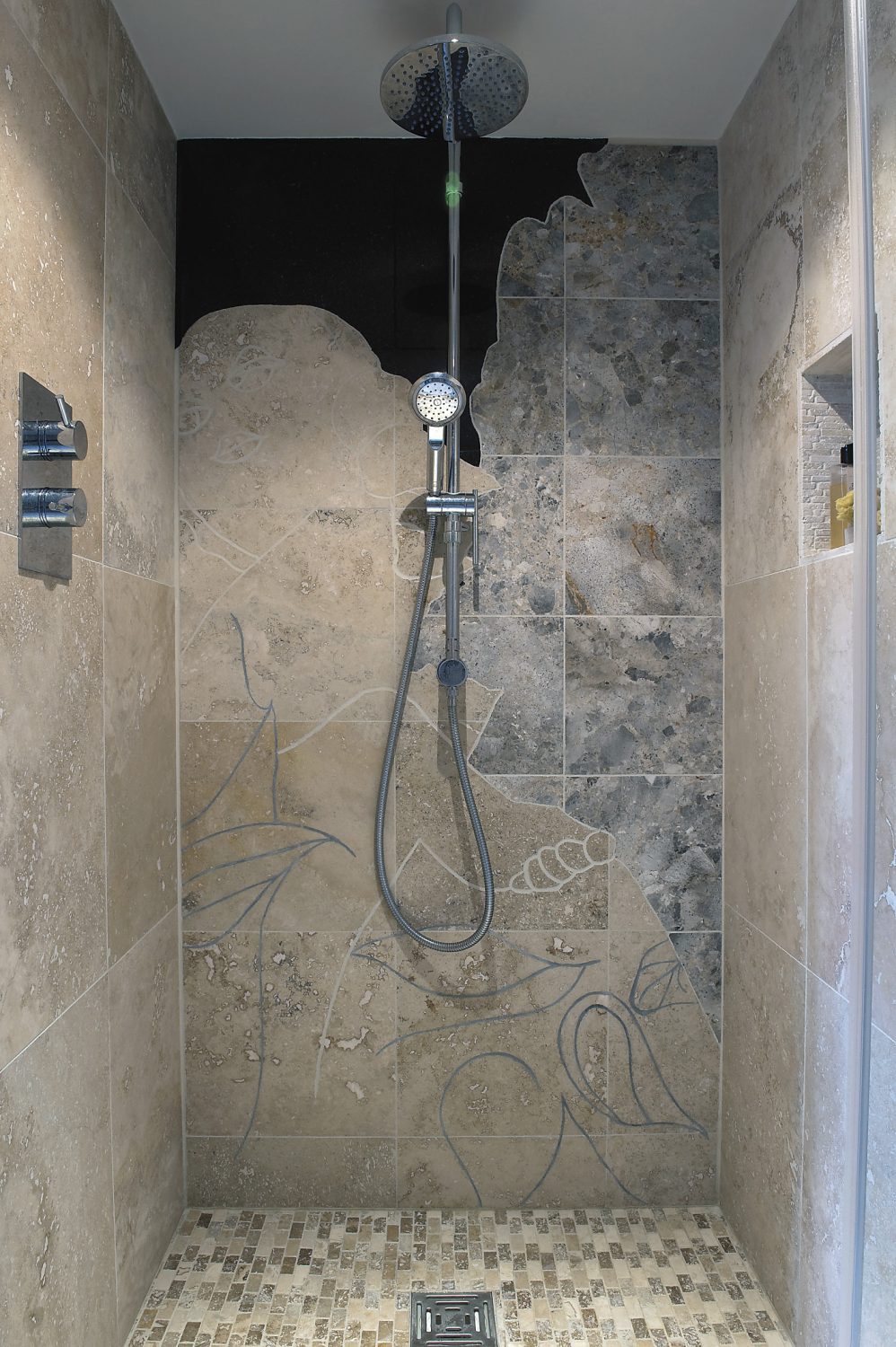Sally hand cut the stone in her walk-in shower to create a design by her brother, the artist Gary Hume
