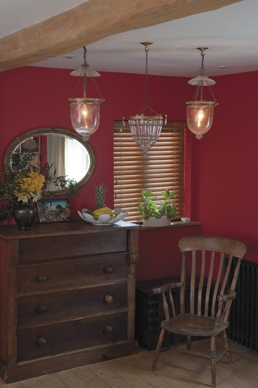 the kitchen in the cottage are both painted a vibrant cherry red