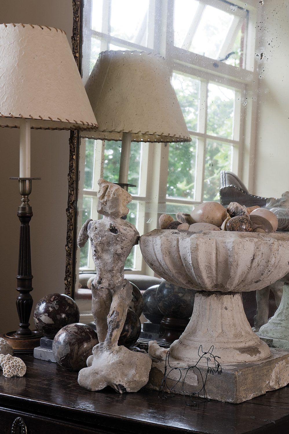 Fascinating collections of trinkets and sculptures adorn surfaces throughout the house