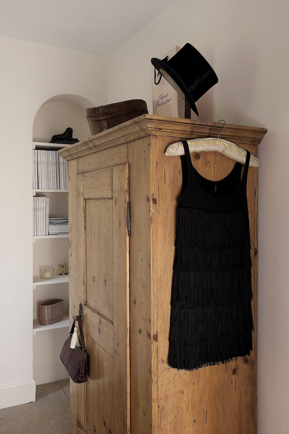Holly's room is simply furnished, with a Victorian brass and iron bed. A beaded silk dress lies on the linen bedcover and looks very much like a vintage find, but in fact, Sally says it's a high street gem that Holly's expert eye spotted